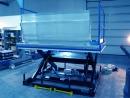 Klapy przeładunkowe: Wykonanie specjalne w wersji mostku aluminiowego dla zwiększonego odstępu między dźwignikiem a paką pojazdu.